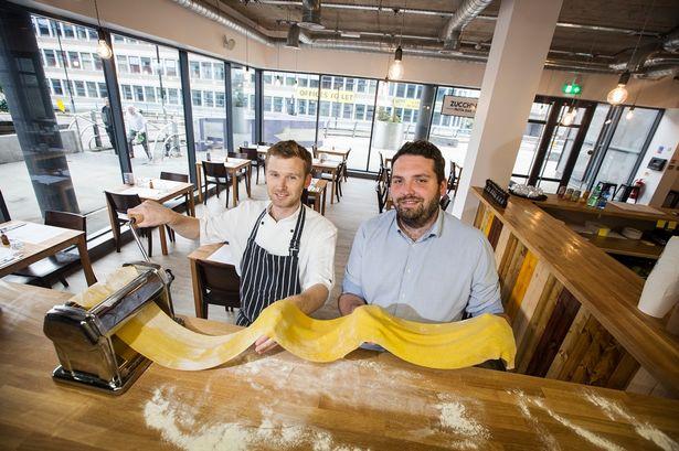 Two people making pasta